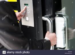 digital office door handle locks. Man Entering Security Code To Unlock The Door - Stock Image Digital Office Handle Locks