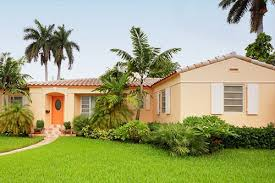 p beautiful florida lawn in front of home with palm trees and natural flora