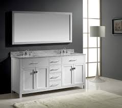 white framed mirror above white cabinet with marble countertop and vanity sink for bathroom mirror