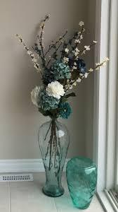 Sea glass floor vase with flowers.