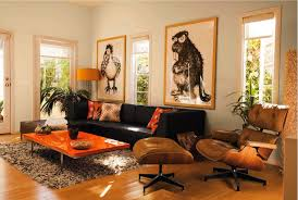 Dark brown couch, orange accents, side chair and ottaman, lamp and ...