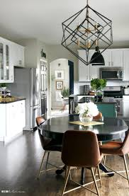kitchen reveal part 2 black and gold geometric chandelier with black pendants over kitchen island new kitchen lighting this is our bliss