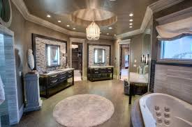 traditional master bathroom with tray ceiling chandelier and a corner tub