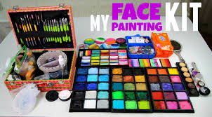 my face painting set up paints brushes workplace organizing you