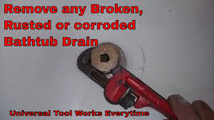 how to remove and change an old stuck bath tub drain with broken cross members