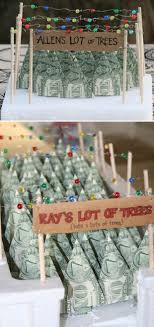 the display of origami forest is super cute and these trees made out of dollar bills are a fun way to give money gift