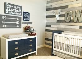 navy and gray nursery with wood accent wall