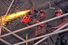 u s department of defense photo essay  u s navy petty officer 3rd class michael rack uses an angle grinder to remove steel bars