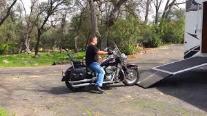loading and unloading a harley sofl from a cougar 310srx toy hauler