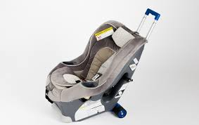 if you do decide to carry on a car seat you will need a transport system like this