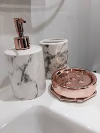 copper coloured bathroom accessories. i chose items for the bathroom because they match counters but rose gold help copper coloured accessories r