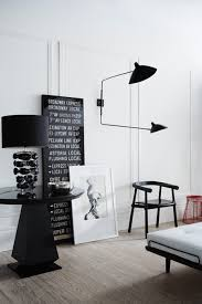 black and white interior design lamp and picture frames black white interior design
