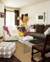 lucite tables are always a chic addition to a living room they work well paired with a dark brown couch and a light brown rug