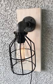 black pipe cage wall sconce industrial