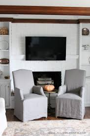 use hollow floating shelves for a mantel to hide television cords julie blanner