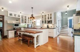 white traditional kitchen with breakfast bar island bench dining seat