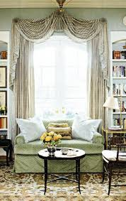 The formal swags across the top of the window are accented with jabots on  the sides, and gathered in decorative pleats in the middle