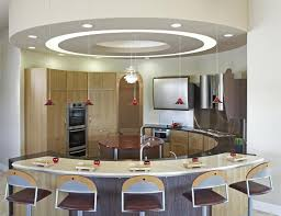 advantages of kitchen gypsum ceiling design with mini pendant lamps above curved bar design