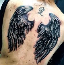 татуировка на спине у девушки крылья фото рисунки эскизы