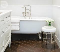 bathroom with porcelain wood like tile floor