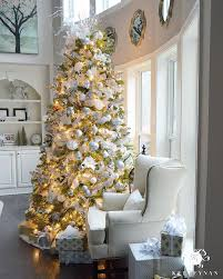9 foot White, Gold, and Silver Christmas Tree, filled with ornaments in two