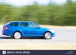 car driving side view. Wonderful View Side View Of A Blue Car Driving On Asphalt Road Against Blurred Trees   Stock Image In Car Driving View F