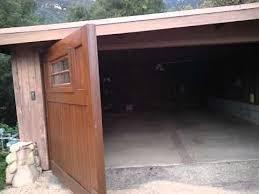open garage doorExotic Wood garage doors swing open Contractors Choice  YouTube