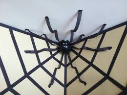How To Make A Giant Spider Web Halloween Decor Giant Spider In A Web Using Streamers And A