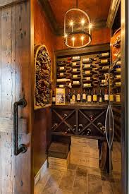 wine room lighting. Wine Cellar Walls Are Paneled In Alder Wood With A Dark Stain The Lighting Is Colwyn Chandelier From Currey And Co Winecellar Hendel Homes Room N