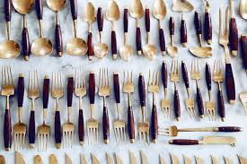 gold and wood silverware bronzeware