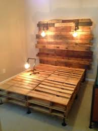 Bed Frame Made Of Pallets And Lights Pallet Bed With Edison Builds And Birdcage Light Frames