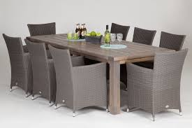 wooden table with 6 rattan chairs and a free cantilever parasol