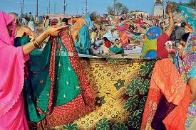 maha kumbh mela pilgrimage by the ganges outlook traveller a riot of colours on the saris worn by women pilgrims at the kumbh full of beautiful floral and traditional patterns