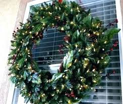 large outdoor lighted wreaths decorated with lights on