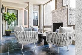 Light Gray Modern Sunroom Chairs with Pebbled Fireplace