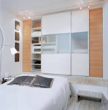 decorating small bedroom gorgeous bedroom design with brown and white sliding doors of bedroom closet