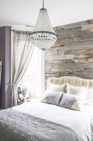 modern bedroom with reclaimed wood accent wall and chandelier ideas