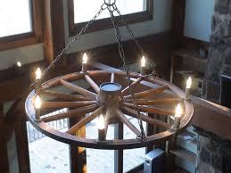 incredible diy wagon wheel chandelier with wagon wheel chandelier kit home decor ideas diy wagon wheel