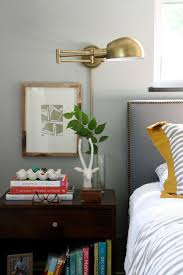wall lighting for bedroom. Livable #bedroom Design With #brass Sconce And Shelf #storage Wall Lighting For Bedroom M