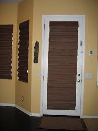 shades for front doorFurniture Woven Wood Flat Roman Shades On White Wooden Single