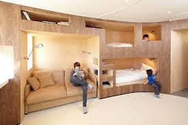 View in gallery Innovative wooden wall with several bunk beds