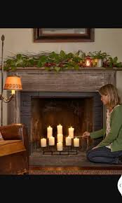 add a low maintenance glow to your fireplace with a large scale candelabra nine candle candelabra