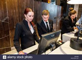 johannesburg south africa african rosebank hyatt regency hotel lobby front desk reservations man woman employee job coworkers working uniform supervis