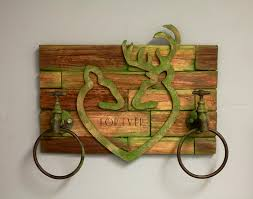 deer heads and hunting themed decor is very trendy and we are loving the options for creative options that are available christy made a rustic wall