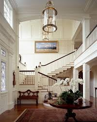 foyer light fixtures entry traditional with acorn finials arch archway image by catalano architects