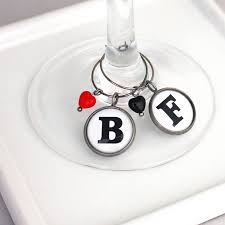 two monochrome initial wine glass charms