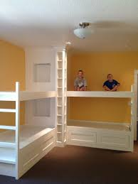 Built in bunk beds with trundle bed. Can sleep many without taking up too  much