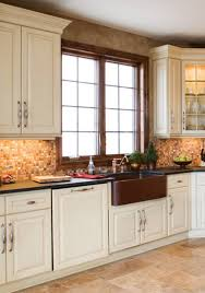 dura supreme cabinetry arcadia classic door style full overlay finished in antique white