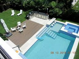 backyard pool bar. Swimming Pool With Swim-up Bar (connected To Outdoor Kitchen) \u0026 Hot Tub At Luxury Home In Biscayne, Florida Backyard