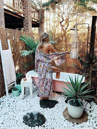 outdoor bath spell the gypsy collective excellent baths ideas decor winter bathroom bathtub small awesome mom brushing hair of her c